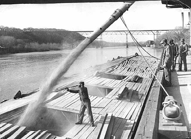 First barge being loaded with corn at Farmers' Union Grain